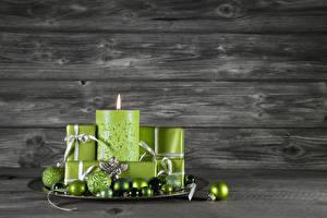 Fotos Neujahr Kerzen Bretter Kugeln Hellgrüne