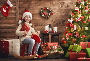Photo Christmas Christmas tree Present Little girls Winter hat Joyful Children