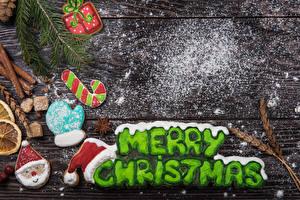 Bilder Neujahr Kekse Zimt Puderzucker Bretter Englisch Fausthandschuhe