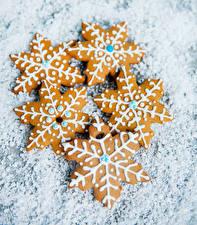 Fotos Neujahr Kekse Schneeflocken Lebensmittel