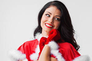 Wallpapers New year Gray background Brunette girl Smile Glove young woman