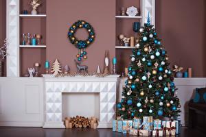 Bilder Neujahr Innenarchitektur Kerzen Tannenbaum Geschenke Kugeln