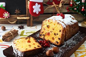 Fotos Neujahr Keks Schalenobst Puderzucker Beere Rosinen Schneidebrett