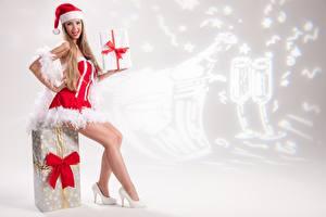 Pictures New year Uniform Winter hat Sitting Legs High heels Bow Present Girls