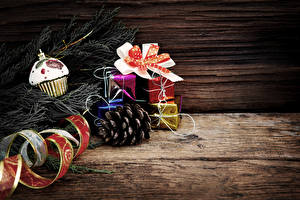 Wallpaper Christmas Wood planks Branches Pine cone Gifts Ribbon Bowknot