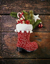 Wallpapers Christmas Wood planks Wearing boots Branches Balls Gifts