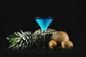 Images Mixed drink Pineapples Kiwi Coconuts Black background Stemware Food