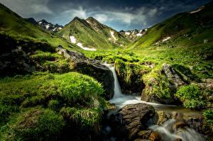 Fotos Frankreich Wasserfall Steine Landschaftsfotografie Hügel Laubmoose Gras Bach