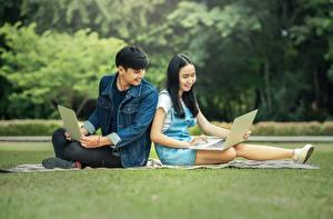 Pictures Men Asian Female students Brunette girl Sitting Laptops