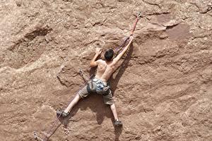 Fotos Mann Bergsteigen Felsen Rücken Bergsteiger Sport