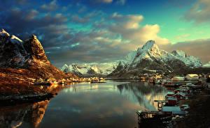 Fotos Norwegen Lofoten Gebirge Winter Gebäude Abend Landschaftsfotografie Bucht Dorf