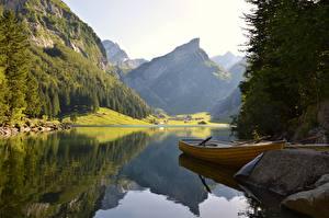 Fotos Steine See Boot Gebirge Wälder Landschaftsfotografie Felsen Natur