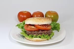 Bilder Tomate Fleischwaren Burger Teller Geschnitten Lebensmittel