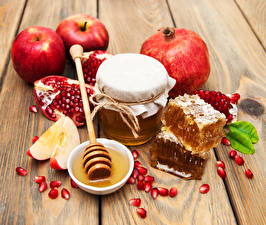 Image Apples Pomegranate Honey Wood planks Jar Grain Food