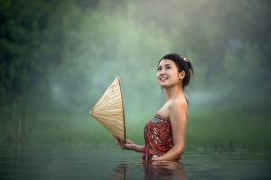 Pictures Asiatic Water Brunette girl Hat Smile female