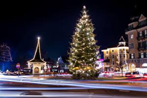 Fotos Österreich Neujahr Gebäude Winter Stadtstraße Tannenbaum Lichterkette Nacht