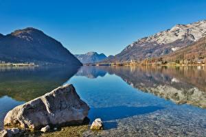 Bilder Österreich Gebirge See Wälder Steine Landschaftsfotografie Alpen Spiegelung Spiegelbild Styria, Grundlsee, Salzkammergut Natur