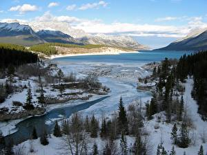 Bilder Kanada Winter Gebirge Flusse See Landschaftsfotografie Schnee Bäume River Klein, Lake Abraham, Western Alberta Natur