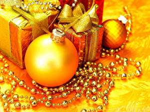 Pictures New year Balls Gifts Gold color