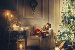 Image New year Candles Teddy bear New Year tree Wing chair Little girls Present Sleep Children