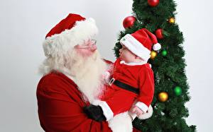 Picture New year New Year tree Balls Gray background Santa Claus Winter hat Eyeglasses Beards Uniform Two Baby child