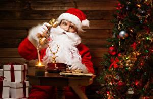 Images New year Christmas tree Present Sitting Winter hat Beard Eyeglasses Telephone