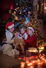 Wallpapers Christmas Christmas tree Little girls Boys Winter hat Fairy lights Children