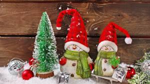 Bilder Neujahr Weihnachtsbaum Schneemänner Zwei Mütze Schal