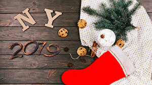 Wallpaper Christmas Cinnamon Cookies Star anise Illicium Wood planks 2019 Branches Wearing boots Balls Marshmallow Food