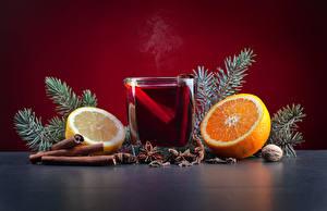 Pictures Christmas Cinnamon Orange fruit Lemons Nuts Star anise Illicium Drinks Highball glass Food