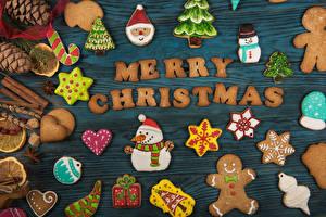 Fotos Neujahr Kekse Bretter Englisch Zapfen Design Schneemänner Schneeflocken Lebensmittel