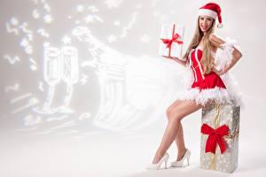 Image New year Present Bowknot Dark Blonde Uniform Sitting Winter hat Legs High heels Girls