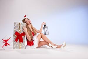 Picture New year Gifts Dark Blonde Uniform Sitting Winter hat Bowknot Lamp Legs High heels Girls