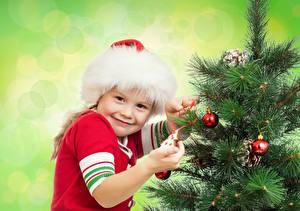 Wallpaper Christmas Little girls Balls Smile Glance Colored background Christmas tree Winter hat Children