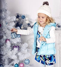 Pictures New year Little girls Smile Winter hat Christmas tree child