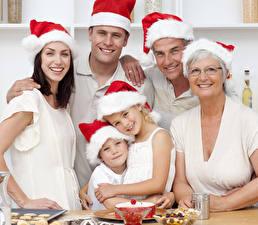Bilder Neujahr Mann Jungen Kleine Mädchen Mütze Lächeln Blick Kinder Mädchens