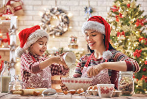 Wallpapers New year Mother Two Little girls Winter hat Smile Hands Children