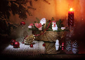Photo New year Still-life Candles Cookies Wicker basket Branches Conifer cone Design Snowman Balls Food