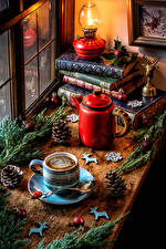 Images New year Still-life Kettle Paraffin lamp Coffee Branches Book Cup Pine cone Balls Food