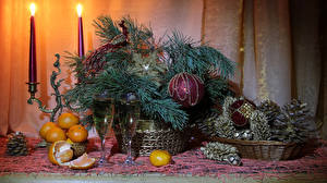 Pictures New year Still-life Mandarine Sparkling wine Candles Branches Balls Stemware Conifer cone Food