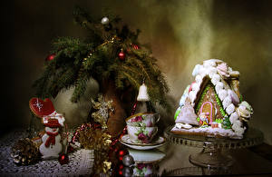 Wallpaper New year Still-life Baking Building Cookies Branches Balls Design Cup Conifer cone Snowman Food