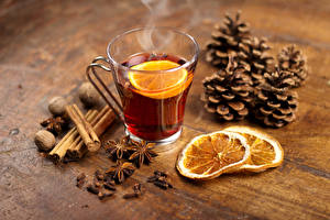 Picture Christmas Tea Lemons Cinnamon Star anise Illicium Nuts Cup Pine cone