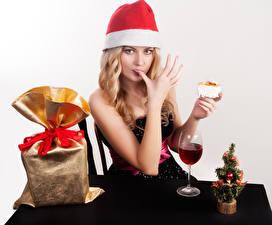 Photo New year Wine Blonde girl Winter hat Gifts Hands Stemware Girls