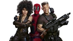 Pictures Deadpool hero Assault rifle Gun (Firearm) Men White background Three 3 Deadpool 2 Movies