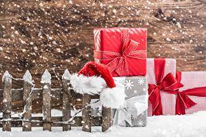 Bilder Zaun Mütze Geschenke Schleife Schneeflocken