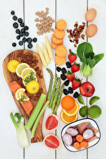Photo Fruit Vegetables Nuts Fish - Food Strawberry Blueberries Citrus Wood planks Cutting board