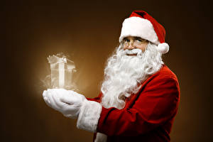 Pictures Sorcery Santa Claus Winter hat Eyeglasses Beard Gifts