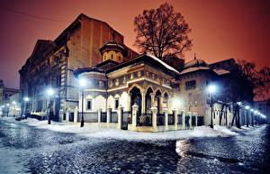 Photo Romania Houses Winter Street Night Street lights Fence Bucharest Cities