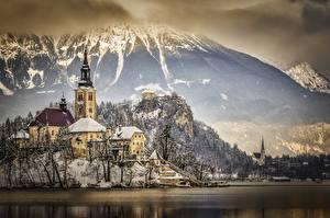 Image Slovenia Winter Mountains Lake Castles Alps Snow Crag Lake Bled, Bled castle Nature