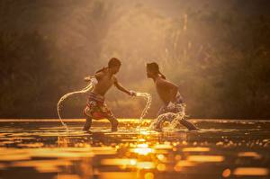 Images Sunrise and sunset Asian Water 2 Fight Boys Children